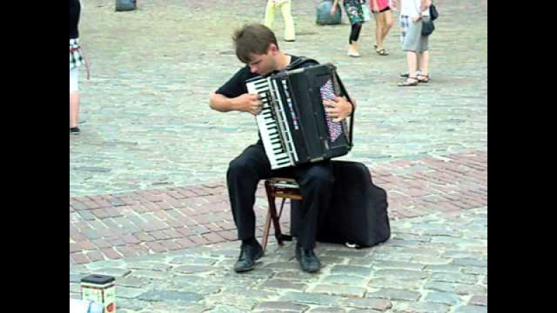 Street artist playing Vivaldi on accordion