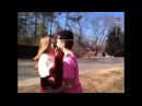 Boy runs up and kisses girl