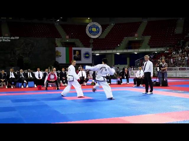 Evgeny Otsimik (Rus) v Ri Chung Il (DPRK). -57kg Male Sparring Final. ITF World Championships 2013