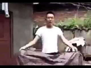 LiveLeak - Chinese man do a disapperance magic that you should never try at home