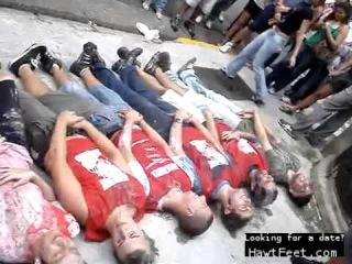 Brazilian girls walking over boys as they cover their balls (femdom)