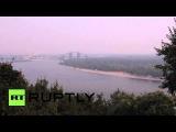 Украина: Дым заполняет Киев небо, как пожары бушуют в Белая Диброва лесу.