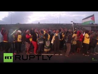 Южная Африка: Про-Палестина протестующие против США ралли певицы Фаррелл Уильямс.