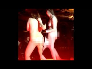 Two young women strip naked 'to win old iPhone' in nightclub as stunned clubbers look on