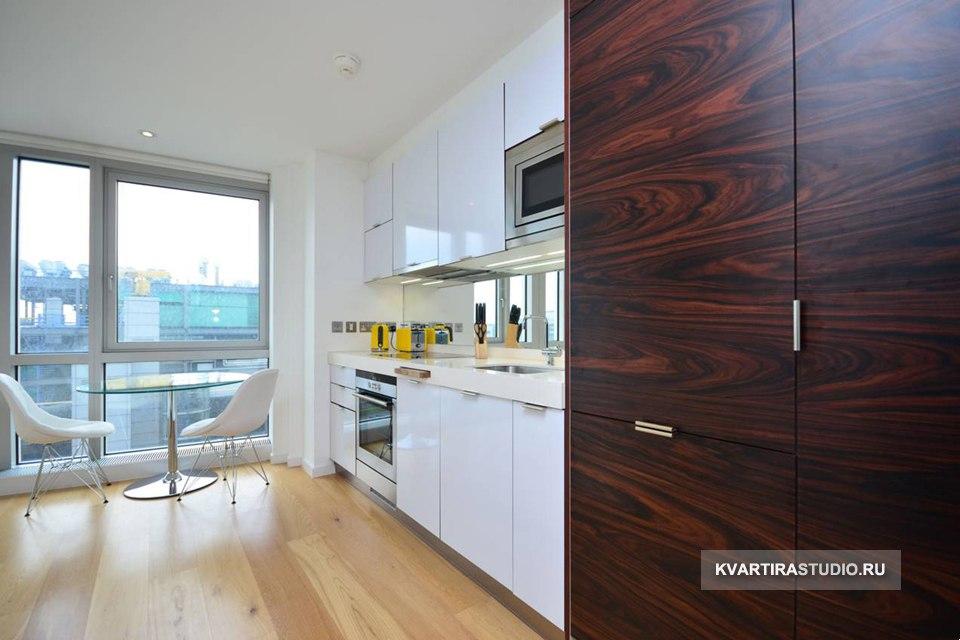 Современная студия 33 м с подъемной кроватью-столом в Лондоне / Англия - http://kvartirastudio.