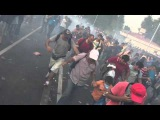 Hungarian police use water cannon &amp tear gas on crowd of migrants at Hungary-Serbia border