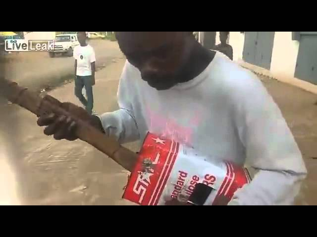Liberian blind man is successful on the internet with tin guitar.