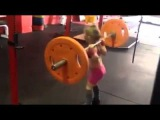This 7 year old girl shows A good example of technique correct of squats
