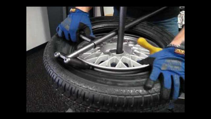 Change a car tire on a No-Mar scratch proof tire changer