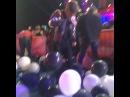 Austin Mahone pops balloons.