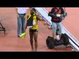 Chinese Cameraman falls on Usain Bolt after Men's 200m Final IAAF 2015.
