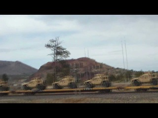 Military armored vehicles on train Flagstaff AZ