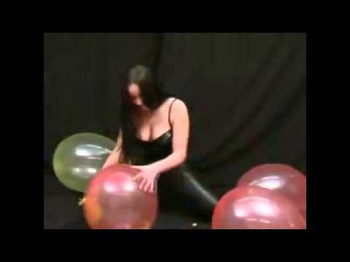 Hot brunette hands explode balloons