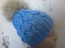 Вязание шапки с объемными косами на спицах.Knitted hat with braids volume on the spokes.