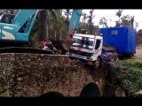LiveLeak - Excavator rescues truck from bridge