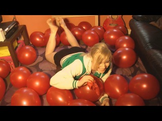 girl in bare feet popping balloons