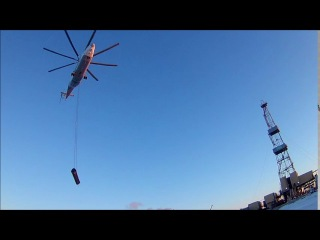 Mi-26 The Largest helicopter delivers pipe to drilling rig