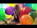 Girl blow to pop big purple balloon