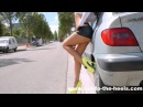 A sexy hooker walking in 18 cm high heels and micro skirt, in the street