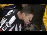 Referee Tim Peel gets repairs from Predators bench, stays in game