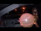 Jesse Espino - Girl blowing up punch ball Critter balloon