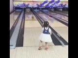 Little girl knock strike in bowling