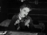 Чарли Чаплин,к_ф Золотая лихорадка 1925 год, Танец с булочками