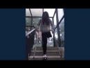 Cute Chinese amputee girl having fun on crutches