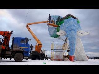 Установка уха на статую слона