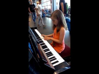 Young airport piano player Diane Lambiet
