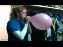 Cool girl blowing up a pink balloon until it pops