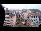 Chinese man saves wife from suicide fall by grabbing ponytail