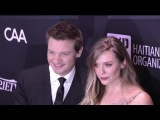 JEREMY RENNER and girlfriend ELIZABETH OLSEN arrive late to Sean Penn benefit concert for Haiti