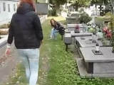 Polish girl spits on the graves of soldiers at the cementery