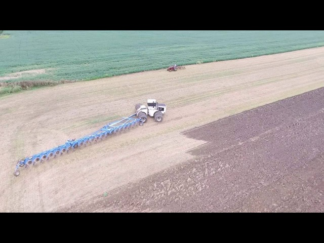 Big Bud Pulling HUGE 21 Bottom Plow