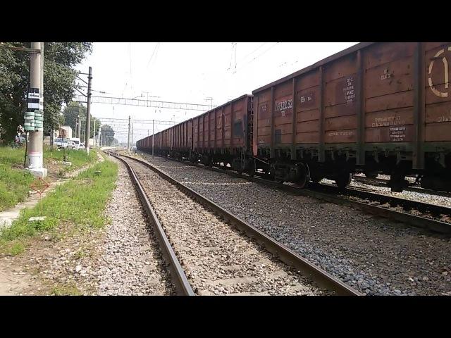 3М62У-0077 с грузовым поездом