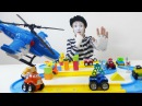 Funny Clown builds new road for toy cars.
