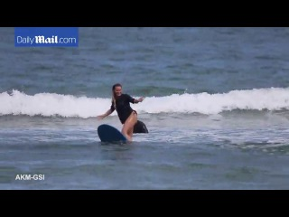 Surfer chic! Hilary Duff shows off impressive skills on board