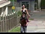 Beautiful mistress ride on shoulders at street.
