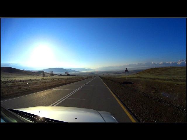 Road in the mountains. Towards the sun: Aktash-Kuray. Altai Republic, Siberia, Russia (Full HD)
