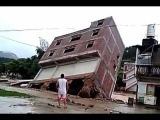LiveLeak - Flood washes building into river