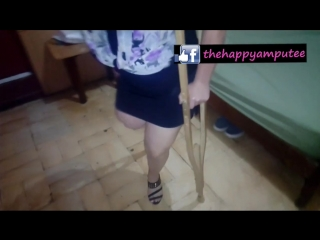 Happy Amputee Walking In High Heel and Crutches