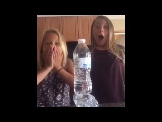 Two girls pull off a double bottle flip with one landing ON TOP of the other