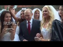Russia: Putin mobbed by young models dressed as brides