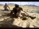 Marines grappling in the sand