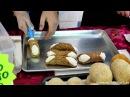 Лондон уличная еда из Сицилии, Италии готовит жареный рис с апельсинами и Сицилийские Каннолию