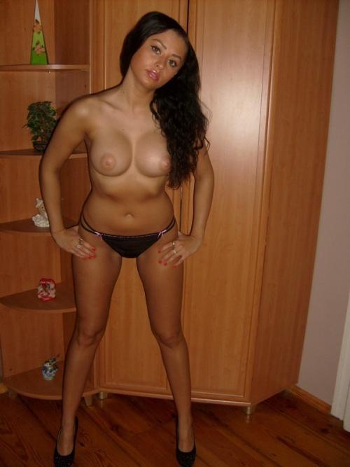 Girl next door massaging her huge boobs