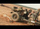 Airbone Soldiers Firing the Little But Powerful M119 After a Sling Load Drop