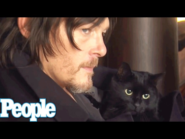 Norman Reedus Poses with his Adorable Cat | People