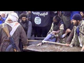 ЖЕСТЬ! ИГИЛ отрубили руку вору! / ISIL chopping off thiefs hand (2015)
